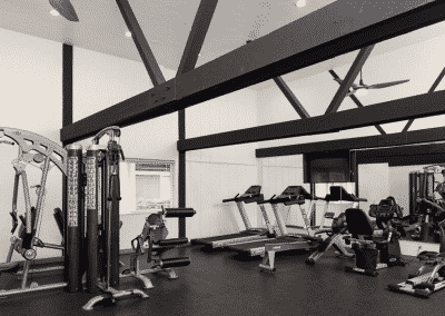 spacious fitness center with exposed beams