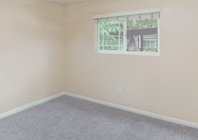 Empty carpeted bedroom with window blinds